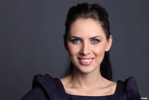 Woman smiling after botox