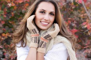 woman Wearing gloves and a scarf