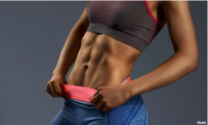 Woman with abs thanks to Emsculpt