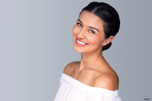 Woman smiling after PRP facial and facelift