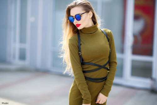 Woman wearing sunglasses and green outfit