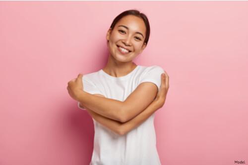 Woman giving herself a hug