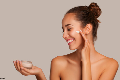 Woman putting out skincare cream